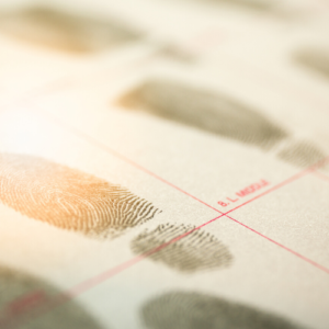 Criminal record document with fingerprints